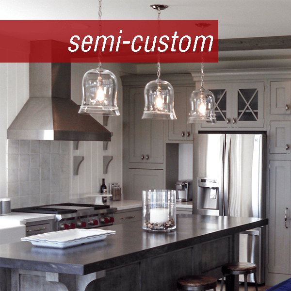 Gorgeous semi-custom kitchen with multiple grey and white-toned cabinetry. Designed by the Wolff Bros. Kitchen Gallery in Sandusky.