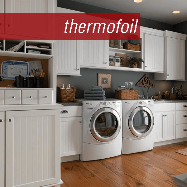 Deluxe laundry room with front load washer and dryer, sink, and tons of storage.  Medallion Silverline Fenwick bead board door with White Thermofoil finish.