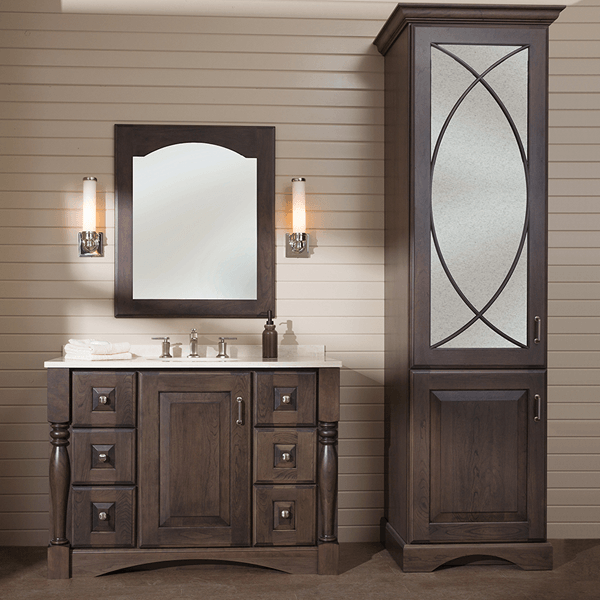 Six drawer, two door traditional vanity with arched tow kick and turned legs with matching linen tower
