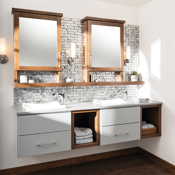 Wall mount asymetrical vanity with drawers below the sink and open shelves to the right, mixed white and cherry finishes.