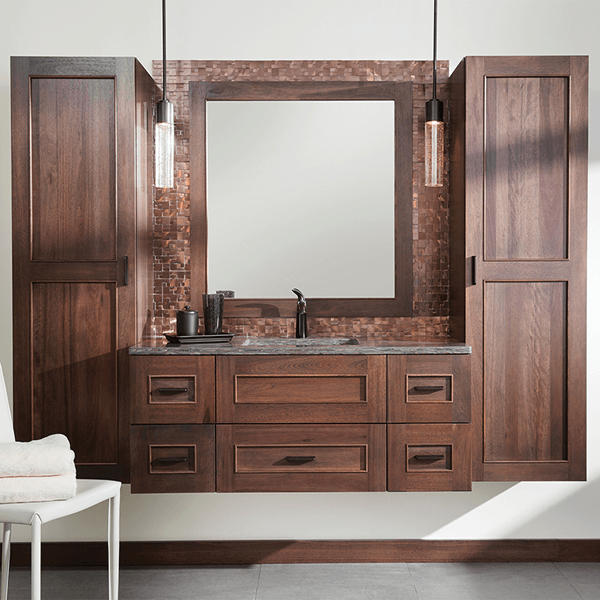 Six drawer wall hung vanity with wall hung storage tower on each side and matching framed mirror in the center