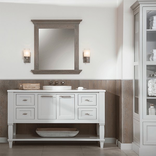 Inset bath cabinetry with Silver Mist paint finish. Mirror and paneling in a contrasting Weathered Finish A in Oak