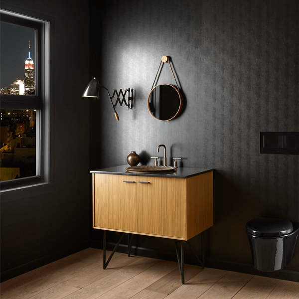 Vertical grained bamboo vanity with double doors and unique zig zag black metal legs with a dark grey top