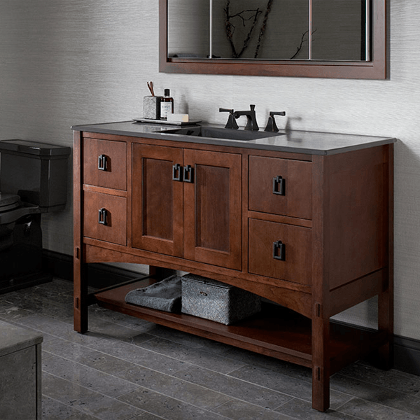 Five foot single bowl vanity in warm reddish brown stain, four drawers, double doors, and open shelf with grey vanity top with rectagular sink