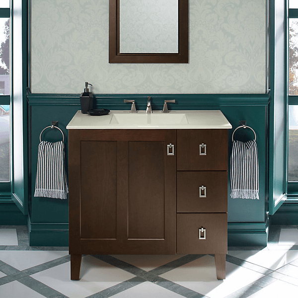 36 inch shaker style vanity with decorative feet, single door and 3 drawers in a warm dark brown stain.
