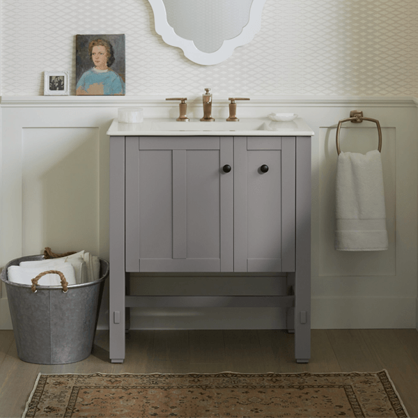 Long legged shaker vanity with single hinged door and pullout sotrage in medium grey paint with oil rubbed bronze hardware
