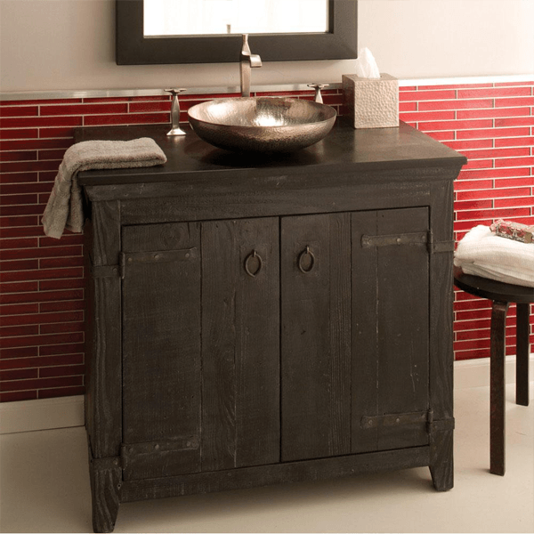 Dark rustic vanity made of reclaimed barnwood with doubel doors and dark wood top to match with copper vessel.