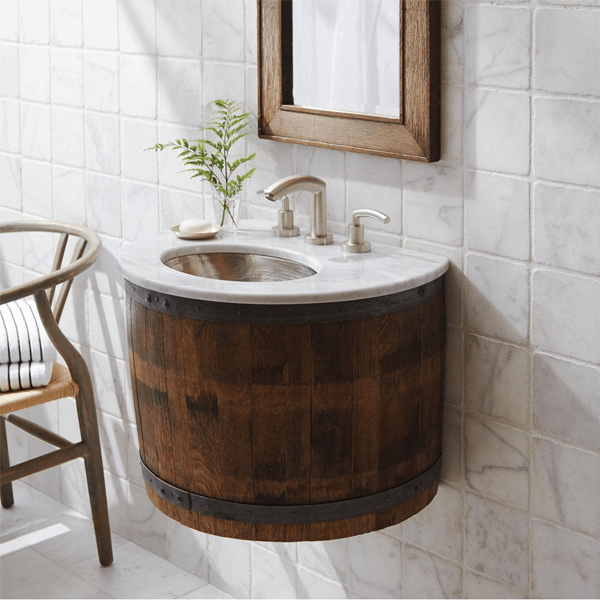 Half used wine barrel wall mounted to create a unique vanity or small wet bar. Shown with a marble top.