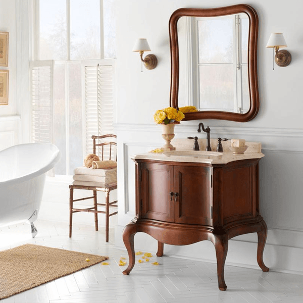 vanity with double doors and elegantly curved faceframe and legs with creme stone top